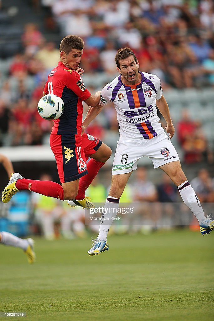 Dario Vidosic of Adelaide competes in the air with Dean Heffernan of Perth during the round 16 A-League match between Adelaide United and the Perth Glory at Hindmarsh Stadium on January 11, 2013 in Adelaide, Australia.