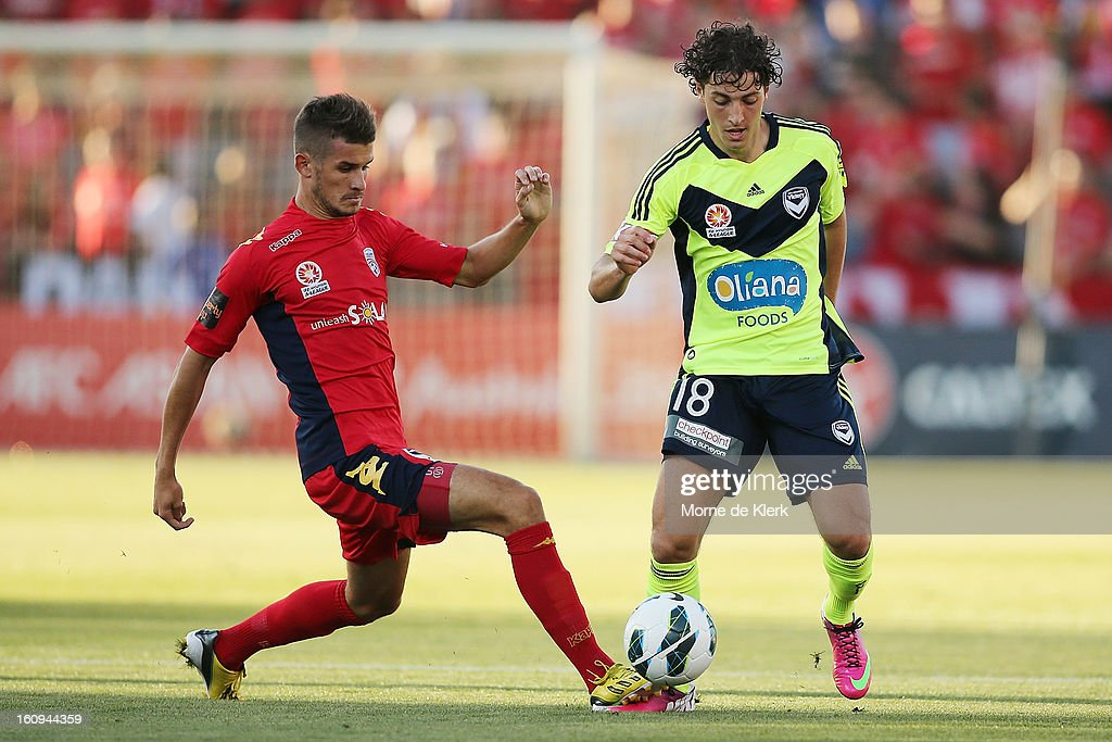 Dario Vidosic of Adelaide competes with Francesco Stella of Melbourne during the round 20 A-League match between Adelaide United and the Melbourne Victory at Hindmarsh Stadium on February 8, 2013 in Adelaide, Australia.