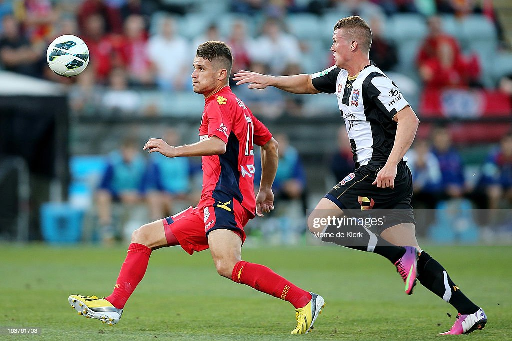Dario Vidosic of Adelaide gets away from Dominik Ritter of the Jets during the round 25 A-League match between Adelaide United and the Newcastle Jets at Hindmarsh Stadium on March 15, 2013 in Adelaide, Australia.