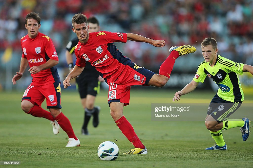 Dario Vidosic of Adelaide passes the ball during the round 20 A-League match between Adelaide United and the Melbourne Victory at Hindmarsh Stadium on February 8, 2013 in Adelaide, Australia.