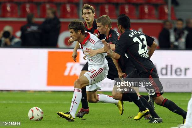 Dario Vidosic of Nuernberg eludes Arturo Vidal Lars Bender and Stefan Reinartz of Leverkusen during the Bundesliga match between Bayer Leverkusen and...
