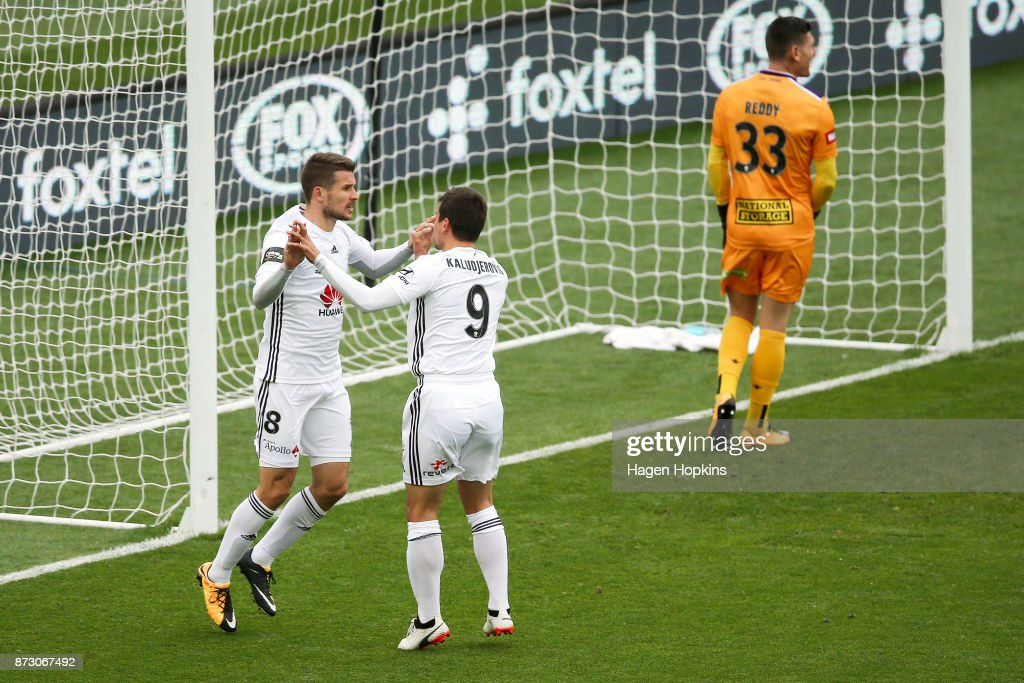 Dario Vidosic of the Phoenix celebrates with teammate Andrija Kaludjerovic after scoring a goal while Liam Reddy of the Glory looks on in disappointment during the round six A-League match between the Wellington Phoenix and the Perth Glory at Westpac Stadium on November 12, 2017 in Wellington, New Zealand.