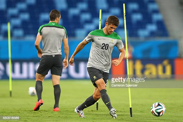 Dario Vidosic of the Socceroos dribbles the ball during an Australian Socceroos training session at Arena Pantanal on June 12 2014 in Cuiaba Brazil