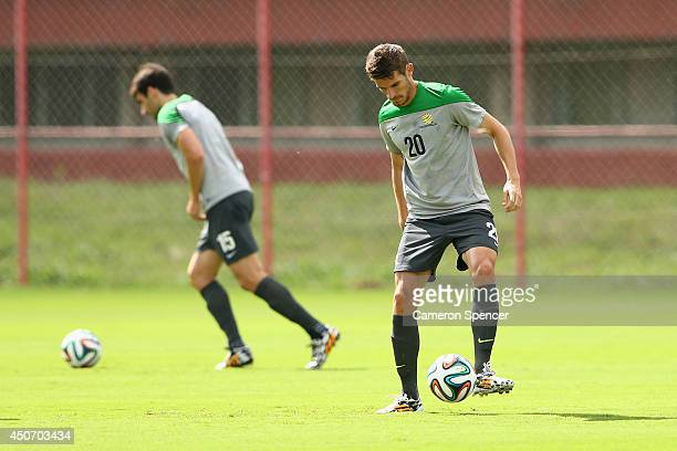 Dario Vidosic of the Socceroos passes during an Australian Socceroos training session and press conference at Arena Unimed Sicoob on June 16 2014 in...