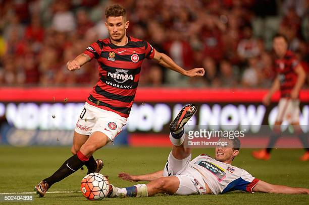 Dario Vidosic of the Wanderers beats a tackle by Mateo Poljak of the Jets during the round 12 ALeague match between the Western Sydney Wanderers and...