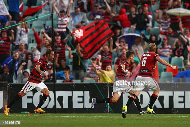 Dario Vidosic of the Wanderers celebrates scoring a goal during the round four ALeague match between the Western Sydney Wanderers and Perth Glory at...
