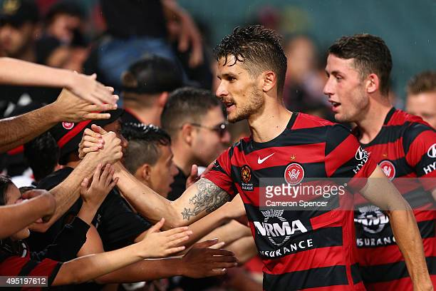 Dario Vidosic of the Wanderers celebrates with fans after winning the round four ALeague match between the Western Sydney Wanderers and Perth Glory...