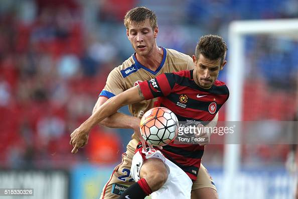 Dario Vidosic of the Wanderers contests the ball with Lachlan Jackson of the Jets during the round 23 ALeague match between the Newcastle Jets and...