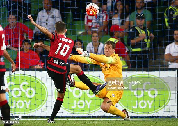 Dario Vidosic of the Wanderers has his shot on goal saved by goalkeeper Thomas Sorensen of City FC during the round 14 ALeague match between...