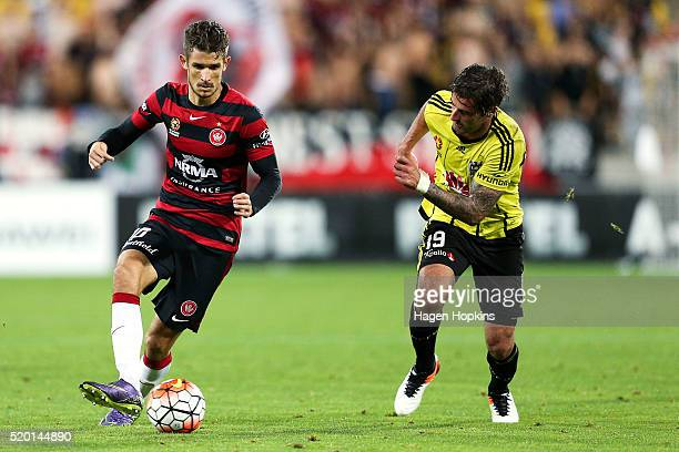 Dario Vidosic of the Wanderers passes under pressure from Tom Doyle of the Phoenix during the round 27 ALeague match between the Wellington Phoenix...