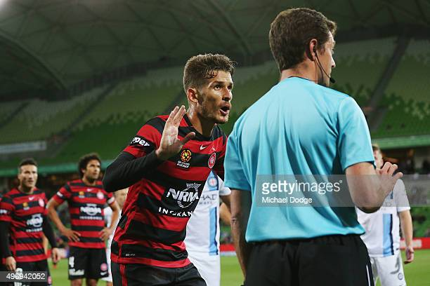 Dario Vidosic of the Wanderers speaks to the linesman after a goal by teamate Frederico Piovaccari is replayed during the round six ALeague match...