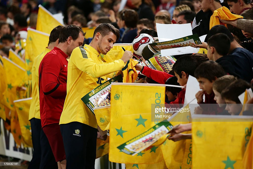 Dario Vidosic signs autographs for fans during an Australian Socceroos training session at WIN Jubilee Stadium on June 13, 2013 in Sydney, Australia.