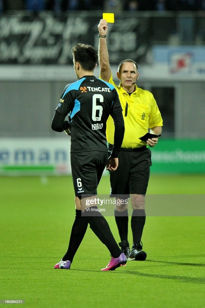 Dario Vujicevic of Heracles Almelo, referee Bossen during the Dutch Cup match between PEC Zwolle and Heracles Almelo at the IJsseldelta Stadium on january 30, 2013 in Zwolle, The Netherlands