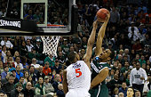 Darion Atkins of the Virginia Cavaliers blocks Alvin Ellis III of the Michigan State Spartans during the third round of the 2015 NCAA Men's...