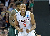 Darion Atkins of the Virginia Cavaliers reacts against the Michigan State Spartans during the third round of the 2015 NCAA Men's Basketball...