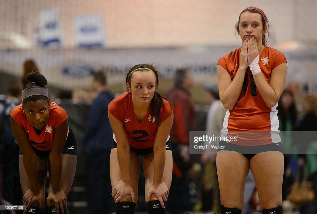 Darion Bucknor, Baylee Bates and Faith Whiteley of Texas Image, Grand Prairie, TX, watch their game against the Evolution Volleyball Club, Alexandria, VA, during the Colorado Crossroads National Qualifier volleyball tournament at the Colorado Convention Center in Denver, CO March 02, 2013. The event, held over two weekends, is one of nine national tournaments that lead up to the USA Junior National Girls' Volleyball Championships. Close to 700 teams will play on 89 courts through the weekend.