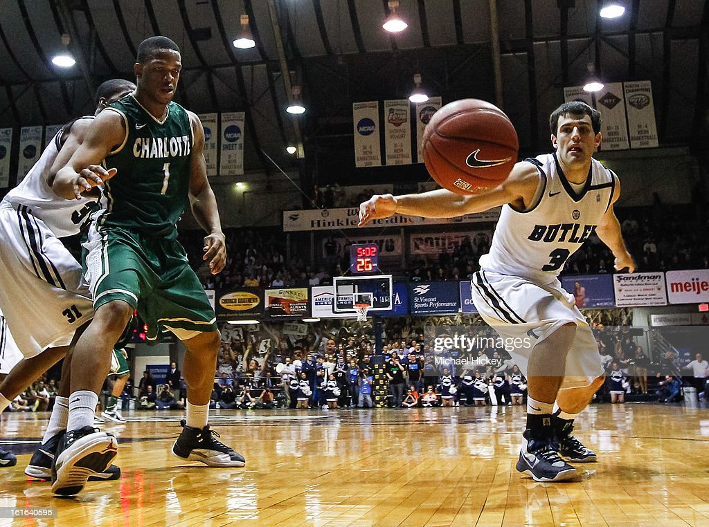 Darion Clark #1 of the Charlotte 49ers and Alex Barlow #3 of the Butler Bulldogs watch a loose ball go out of bounds at Hinkle Fieldhouse on February 13, 2013 in Indianapolis, Indiana. Charlotte defeated Butler 71-67.