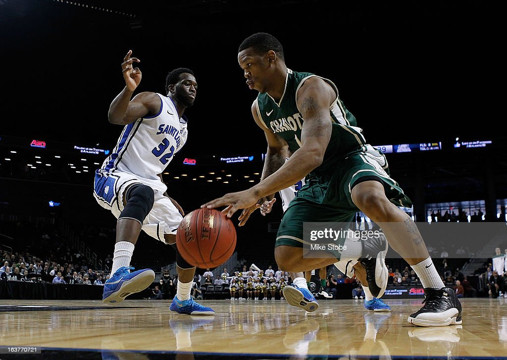 Darion Clark #1 of the Charlotte 49ers drives to the net against Cory Remekun #32 of the Saint Louis Billikens during the Quarterfinals of the Atlantic 10 Basketball Tournament at Barclays Center on March 15, 2013 in the Brooklyn borough of New York City