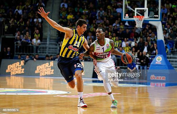 Darius Adams #1 of Laboral Kutxa Vitoria competes with Kenan Sipahi #25 of Fenerbahce Ulker Istanbul during the Euroleague Basketball Top 16 Date 6...