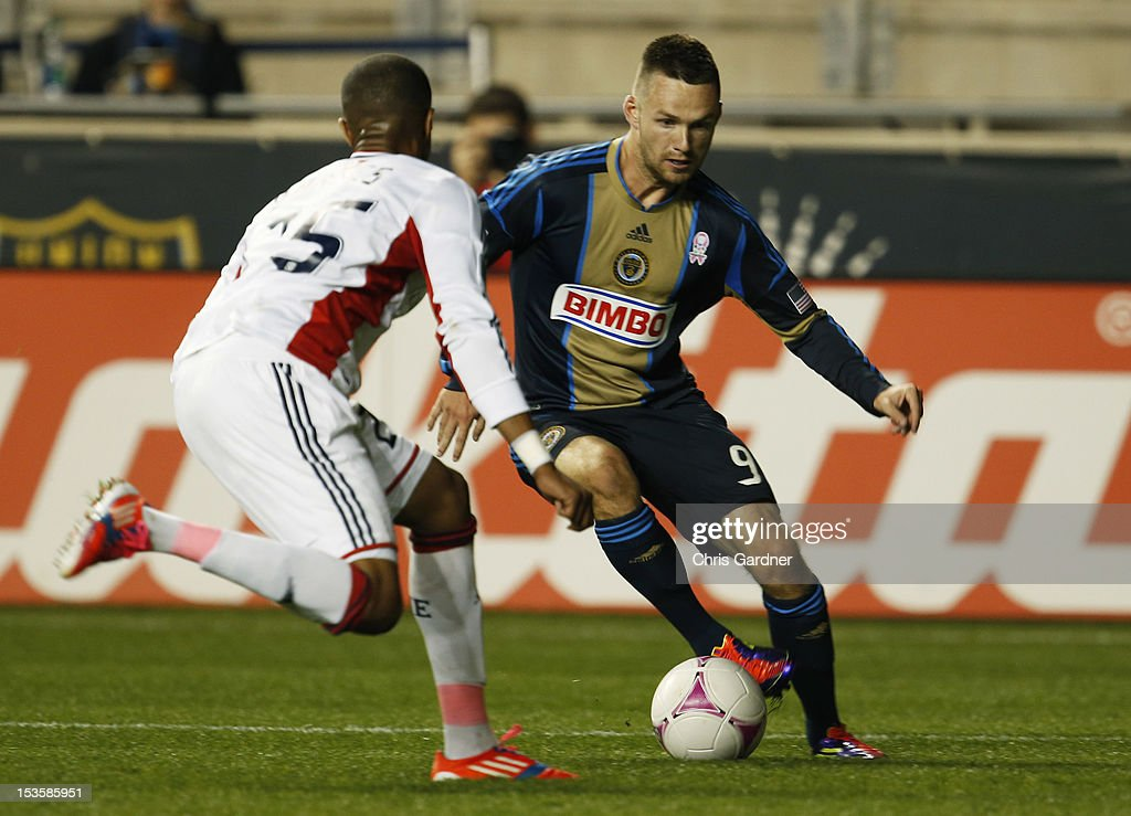 Darius Barnes #25 of the New England Revolution tries to cover Jack McInerney #9 of the Philadelphia Union at PPL Park on October 6, 2012 in Chester, Pennsylvania.