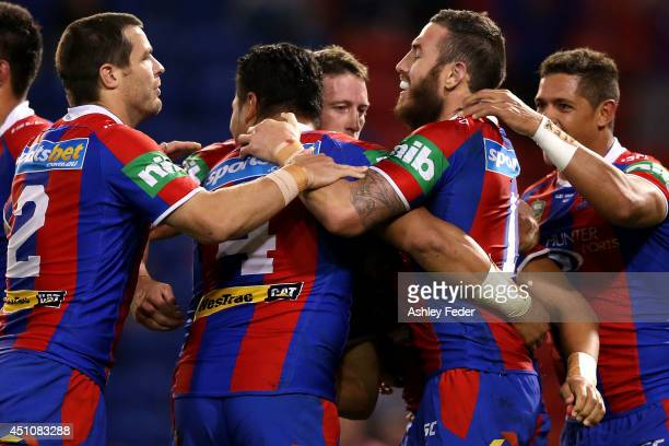 Darius Boyd and Kurt Gidley of the Knights celebrate a try with teammates during the round 15 NRL match between the Newcastle Knights and the North...
