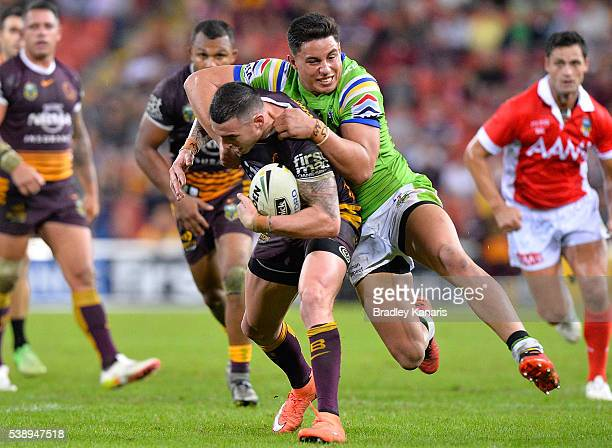 Darius Boyd of the Broncos attempts to break away from the defence during the round 14 NRL match between the Brisbane Broncos and the Canberra...