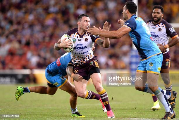 Darius Boyd of the Broncos attempts to break through the defence during the round seven NRL match between the Brisbane Broncos and the Gold Coast...