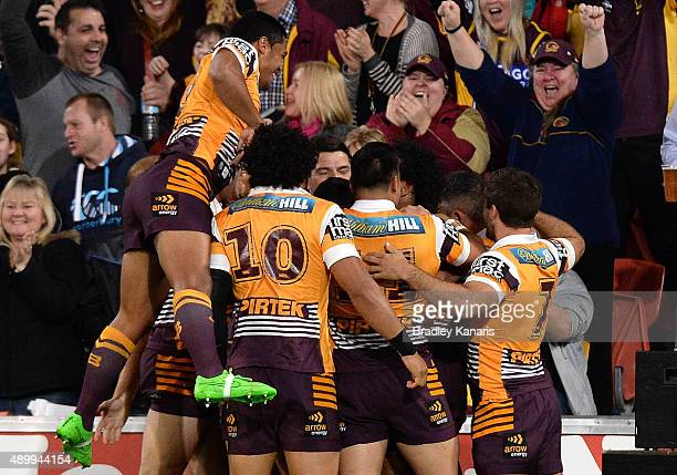 Darius Boyd of the Broncos celebrates scoring a try with team mates during the NRL First Preliminary Final match between the Brisbane Broncos and the...