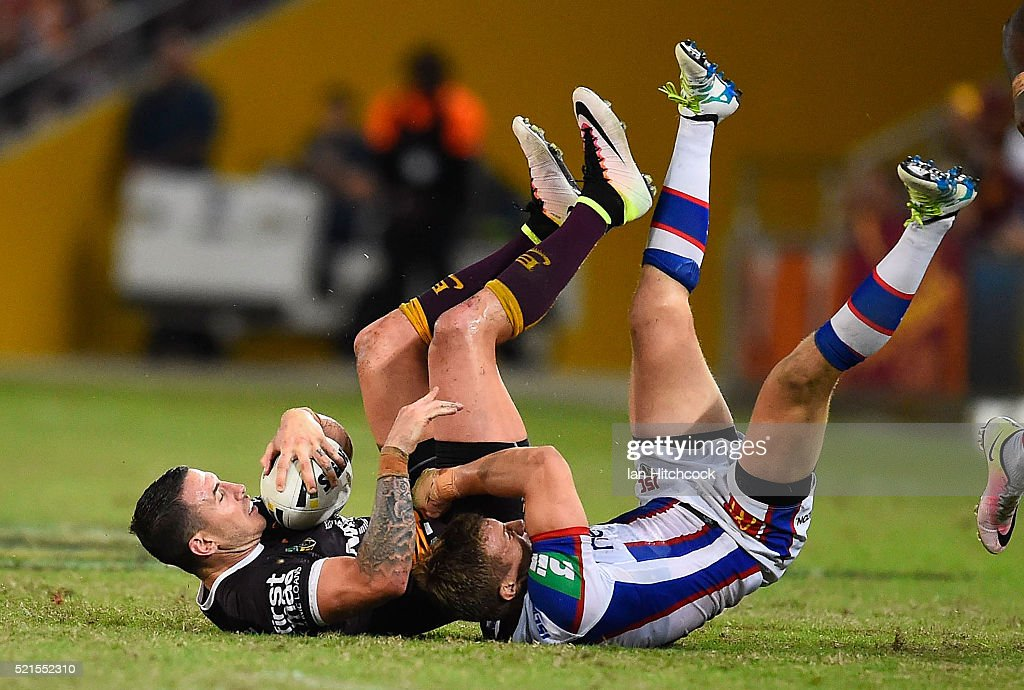 Darius Boyd of the Broncos is tackled by Trent Hodkinson of the Knights during the round seven NRL match between the Brisbane Broncos and the Newcastle Knights at Suncorp Stadium on April 16, 2016 in Brisbane, Australia.