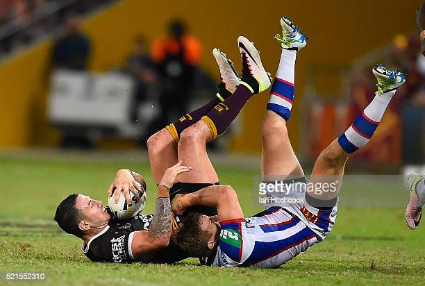 Darius Boyd of the Broncos is tackled by Trent Hodkinson of the Knights during the round seven NRL match between the Brisbane Broncos and the...