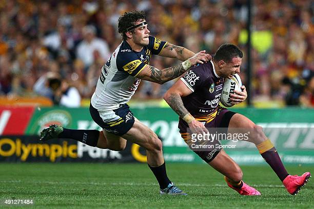 Darius Boyd of the Broncos is tackled during the 2015 NRL Grand Final match between the Brisbane Broncos and the North Queensland Cowboys at ANZ...