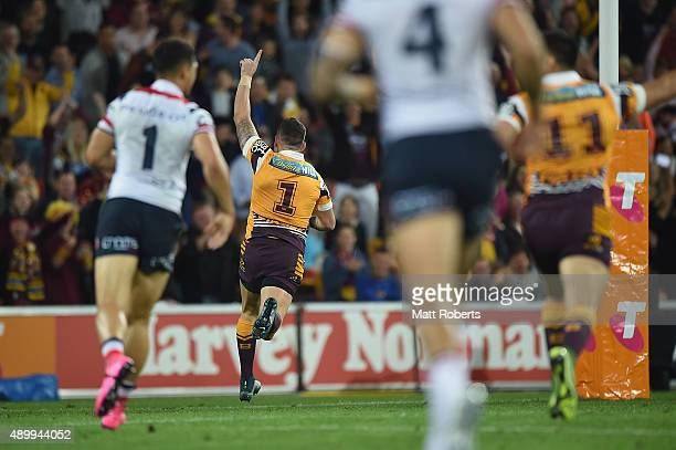Darius Boyd of the Broncos runs in to score a try during the NRL First Preliminary Final match between the Brisbane Broncos and the Sydney Roosters...