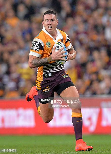 Darius Boyd of the Broncos runs with the ball during the round 20 NRL match between the Brisbane Broncos and the Gold Coast Titans at Suncorp Stadium...