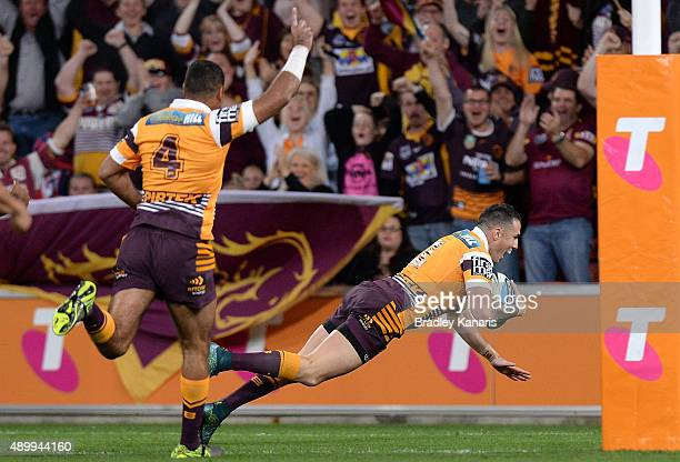 Darius Boyd of the Broncos scores a try during the NRL First Preliminary Final match between the Brisbane Broncos and the Sydney Roosters at Suncorp...