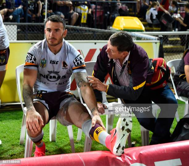 Darius Boyd of the Broncos sits on the bench with ice strapped to his left leg during the round 26 NRL match between the North Queensland Cowboys and...