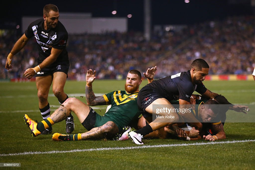 <a gi-track='captionPersonalityLinkClicked' href=/galleries/search?phrase=Darius+Boyd&family=editorial&specificpeople=574047 ng-click='$event.stopPropagation()'>Darius Boyd</a> of the Kanagroos is tackled as he scores a try during the International Rugby League Trans Tasman Test match between the Australian Kangaroos and the New Zealand Kiwis at Hunter Stadium on May 6, 2016 in Newcastle, Australia.