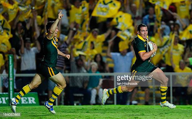 Darius Boyd of the Kangaroos races away to score a try while Cooper Cronk celebrates during the International Test match between the Australian...