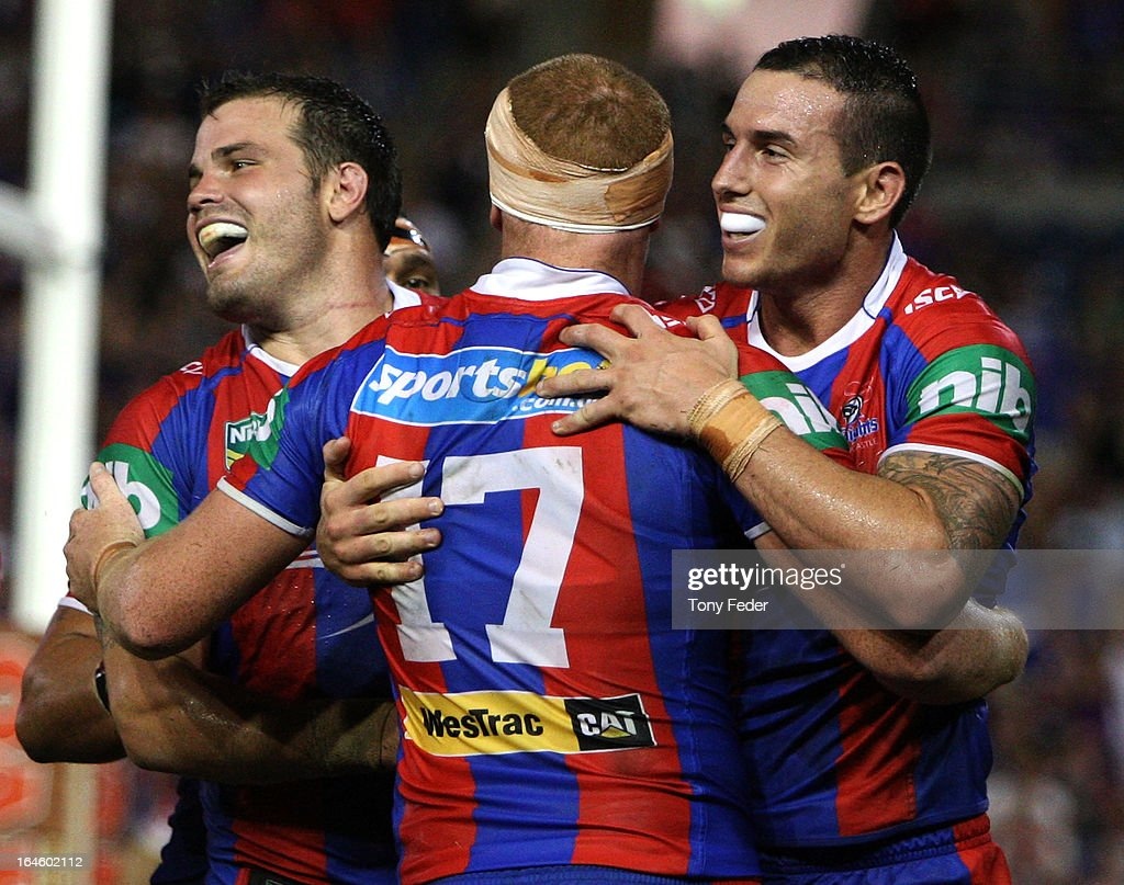 Darius Boyd of the Knights (R) celebrates with team mates after scoring a try during the round three NRL match between the Newcastle Knights and the North Queensland Cowboys at Hunter Stadium on March 25, 2013 in Newcastle, Australia.