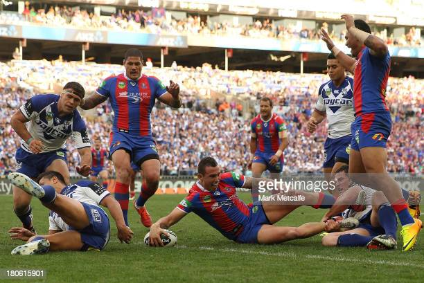 Darius Boyd of the Knights scores a try during the NRL Elimination Final match between the Canterbury Bulldogs and the Newcastle Knights at ANZ...