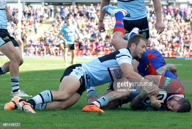 Darius Boyd of the Knights scores a try during the round four NRL match between the Newcastle Knights and the Cronulla Sutherland Sharks at Hunter...