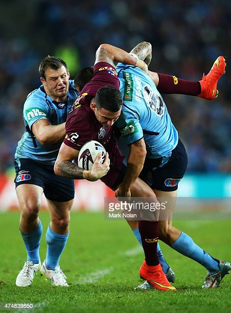 Darius Boyd of the Maroons is tackled during game one of the State of Origin series between the New South Wales Blues and the Queensland Maroons at...