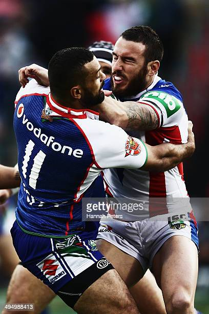 Darius Boyd of the Warriors fends off Jayson Bukuya of the Knights during the round 12 NRL match between the New Zealand Warriors and the Newcastle...