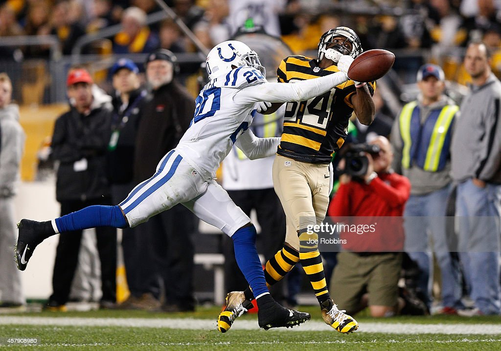 <a gi-track='captionPersonalityLinkClicked' href=/galleries/search?phrase=Darius+Butler&family=editorial&specificpeople=3967703 ng-click='$event.stopPropagation()'>Darius Butler</a> #20 of the Indianapolis Colts breaks up a pass intended for <a gi-track='captionPersonalityLinkClicked' href=/galleries/search?phrase=Antonio+Brown+-+American+Football+Player+-+Born+1988&family=editorial&specificpeople=9758914 ng-click='$event.stopPropagation()'>Antonio Brown</a> #84 of the Pittsburgh Steelers during the fourth quarter at Heinz Field on October 26, 2014 in Pittsburgh, Pennsylvania.