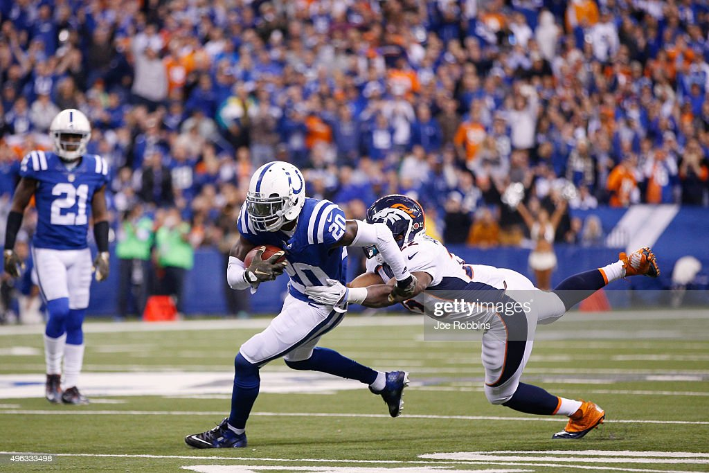<a gi-track='captionPersonalityLinkClicked' href=/galleries/search?phrase=Darius+Butler&family=editorial&specificpeople=3967703 ng-click='$event.stopPropagation()'>Darius Butler</a> #20 of the Indianapolis Colts returns the ball after intercepting a pass from Peyton Manning #18 of the Denver Broncos in the second half of the game at Lucas Oil Stadium on November 8, 2015 in Indianapolis, Indiana. The Colts defeated the Broncos 27-24.