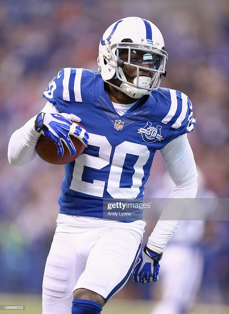<a gi-track='captionPersonalityLinkClicked' href=/galleries/search?phrase=Darius+Butler&family=editorial&specificpeople=3967703 ng-click='$event.stopPropagation()'>Darius Butler</a> #20 of the Indianapolis Colts runs with the ball after intercepting a pass during the NFL game against the Houston Texans at Lucas Oil Stadium on December 15, 2013 in Indianapolis, Indiana.