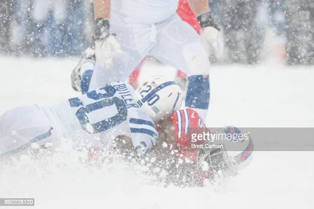 Darius Butler of the Indianapolis Colts tackles LeSean McCoy of the Buffalo Bills during the second quarter at New Era Field on December 10 2017 in...