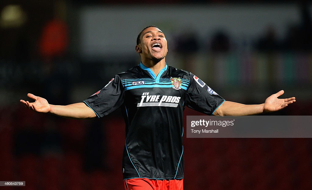 Darius Charles of Stevenage celebrates scoring their third goal during the FA Cup Third Round match between Doncaster Rovers and Stevenage at the...