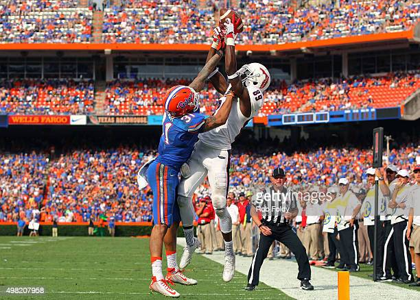 Darius James of the Florida Atlantic Owls goes up for a pass while Jalen Tabor of the Florida Gators defends during the second half of the game at...