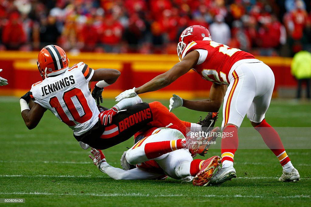 Darius Jennings #10 of the Cleveland Browns is tackled by Ron Parker and Marcus Peters #22 of the Kansas City Chiefs at Arrowhead Stadium during the fourth quarter of the game on December 27, 2015 in Kansas City, Missouri.
