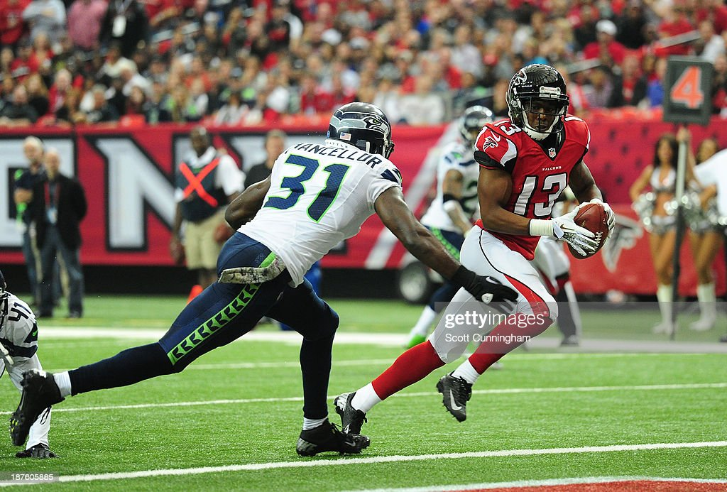 Darius Johnson #13 of the Atlanta Falcons makes a catch for a touchdown against <a gi-track='captionPersonalityLinkClicked' href=/galleries/search?phrase=Kam+Chancellor&family=editorial&specificpeople=4489525 ng-click='$event.stopPropagation()'>Kam Chancellor</a> #31 of the Seattle Seahawks at the Georgia Dome on November 10, 2013 in Atlanta, Georgia.